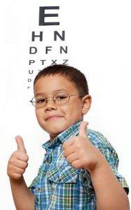 boy in front of eye chart, eye doctor,west palm beach, fl